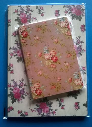 Two rose design notebooks