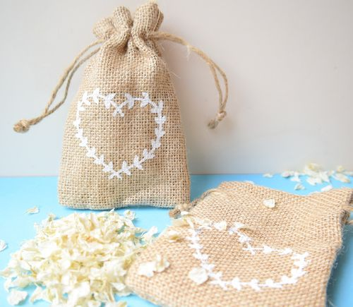 Natural jute bag heart design empty